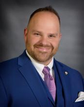 Commissioner Adam Wright
