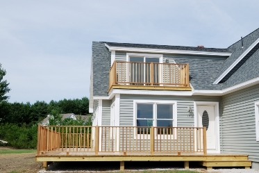 photo of a deck and porch being built on a house
