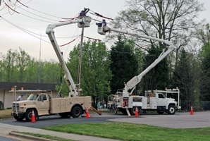 Two Power Trucks working on a power pole